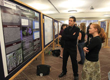 Student consider a presentation at Undergraduate Research Day